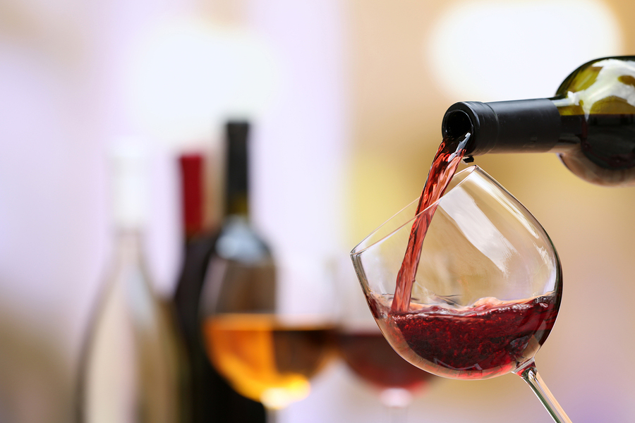 web-bigstock-Red-wine-pouring-into-wine-gla-76405700